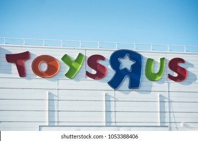 Mulhouse - France - 24 MArch 2018 - Toys r us logo on store on blue sky background . Toys r us is the world's largest chain of toys dealer