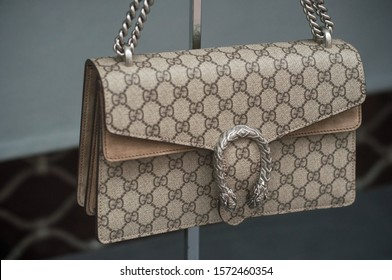 Mulhouse - France - 24 November 2019 - Closeup of beige leather handbag with famous pattern by Gucci in a luxury fashion store showroom