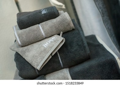Mulhouse - France - 29 September 2019 - closeup of blue and grey bath towels pile fromn Hugo Boss brand in store showroom