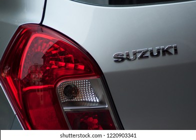 Mulhouse - France - 4 November 2018 - Grey Suzuki rear logo and rear light, Suzuki is a Japanese brand of multinational company which currently produces automotive