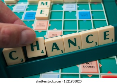 Mulhouse - France - 4 October 2019 - Closeup of plastic letters with word  chance on Scrabble board