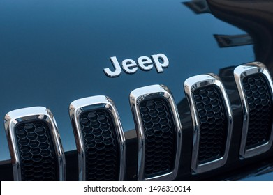Mulhouse - France - 4 September 2019 - Closeup of Jeep logo on black car front parked in the street