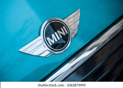 Mulhouse - France - 6 April 2018 - retail of Austin mini cooper logo on blue car parked in the street