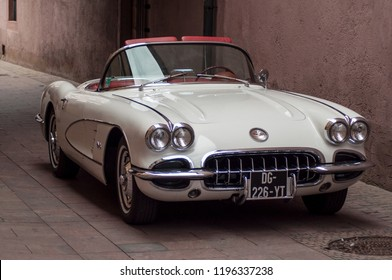 Mulhouse - France - 6 October 2018 - White Chevrolet Corvette convertible from sixties parked in the street