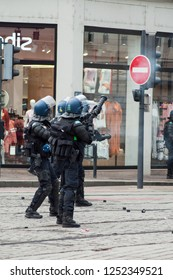 Mulhouse - France - 7 December 2018 - french policemen with throwing grenades during the riot of high school students on the sidelines of the movement of yellow vests