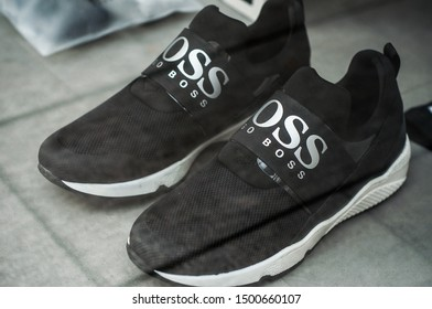 Mulhouse - France - 8 September 2019 - Closeup of black sneakers from Hugo Boss brand in fashion store showroom