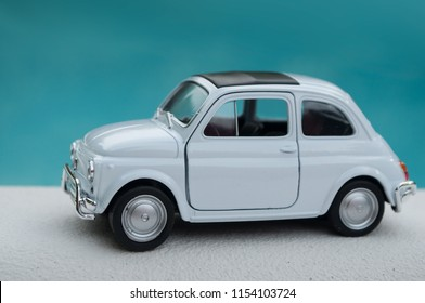 Mulhouse - France - 9 August 2018 - closeup of old fiat 500 on ocean landscape background