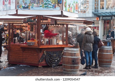 Mulhouse - France - 9 December 2017 - woman serving mulled wine at the christmas market