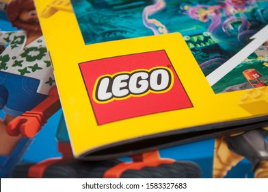 Mulhouse - France - 9 December 2019 - Closeup of lego logo on Lego toys catalog