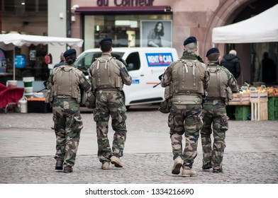 Mulhouse - France - 9 March 2019 - group of military patrolling ion main place