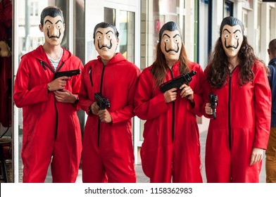 "Mulhouse -  France - August 17 2018 :group of fans of the serie tv ""La casa de papel (paper house)  on Netflix standing in the street with costume and Salvador Dali mask and false shot guns"