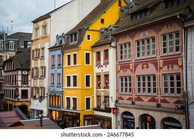 MULHOUSE, FRANCE - DECEMBER 13, 2014: Traditional houses and shops in the main square in Mulhouse, Alsace, France.