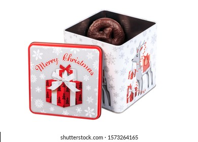 Mulhouse, France - December 29, 2017: Christmas tin box containing gingerbreads coated with dark chocolate - Alsatian specialty during the end-of-year festivities in studio