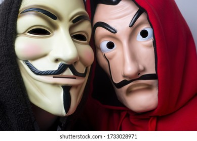 """Mulhouse -  France - May 16 2020 : Portrait of people wearing the  """"La casa de papel (paper house) traduction in english a Salvador Dali mask and vensetta mask symbol of anonymous activists"""