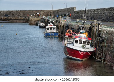Mullaghmore, Ireland- Feb 23, 2020: Fishing boats moored in Mullaghmore Harbour
