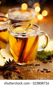 Mulled cider with aromatic spices and citrus fruits. Hot drink perfect for autumn and winter evenings