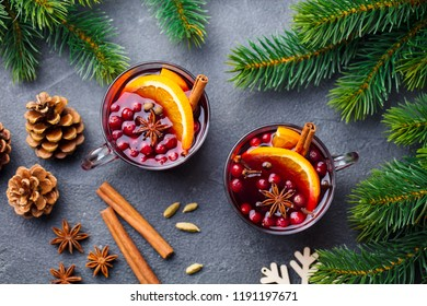 Mulled red wine with spices. Christmas decoration. Grey slate background. Top view.