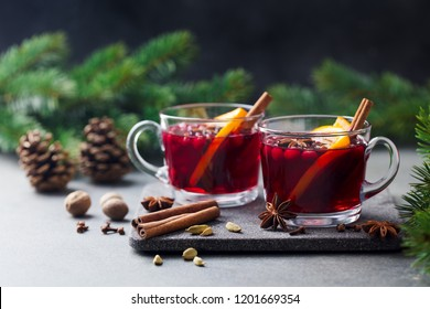 Mulled red wine with spices. Christmas decoration. Grey stone background. Copy space.
