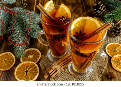 Mulled wine and Christmas composition on the rustic wooden  background