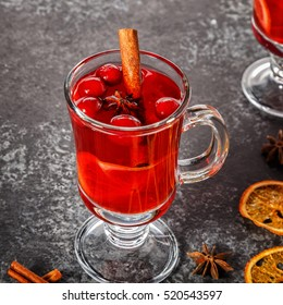 Mulled wine with cinnamon, anise, cranberries and orange, selective focus.