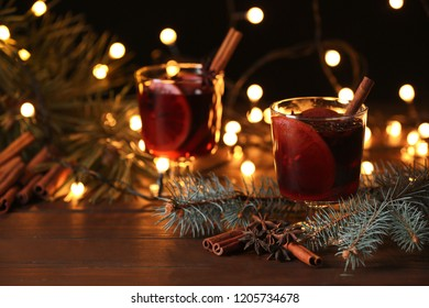 Mulled wine with cinnamon, anise and orange on table. Space for text