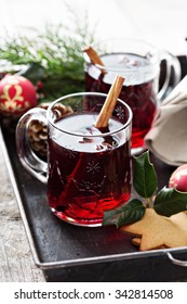 Mulled wine with cinnamon and star anise on a tray