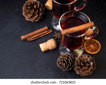Mulled wine with delicious orange and spic on the dark old wood background