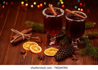 Mulled wine, fir branches, spices and  christmas decoration on a wooden table. Winter holidays.