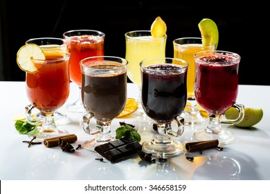 mulled wine. fruit or berry drink. alcohol winter. against a dark background