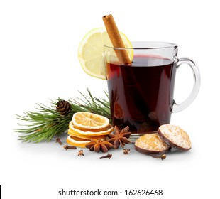 Mulled wine in glass with cinnamon stick, christmas sweets, isolated