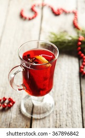 Mulled wine in glass on grey wooden table