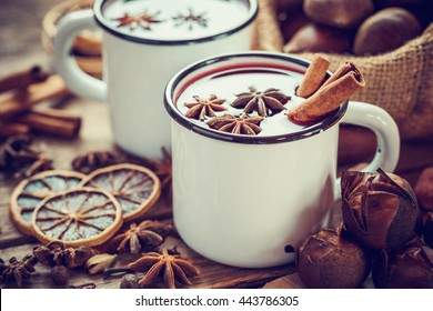 Mulled wine in mugs, dry fruits and roasted chestnuts