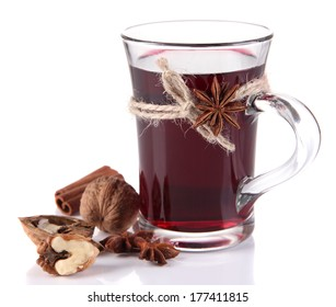 Mulled wine with nuts and spices isolated on white