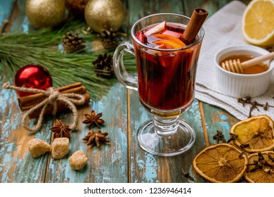 Mulled wine on old wooden background