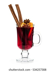 Mulled wine with orange, cinnamon sticks, anise isolated on white background.