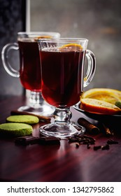 Mulled Wine with pistachio cookies, orange and dark chocolate
