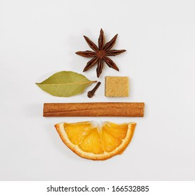 Mulled wine / punch / tea condiments arranged in a creative shape of a smiling face
