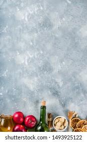 Mulled wine recipe ingredients on grey stone background. Christmas winter warming drink cooking - wine bottle, honey, orange, cinnamon, anise, nutmeg, cloves, sugar