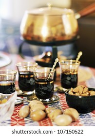 Mulled wine served with raisins and almonds, Sweden.