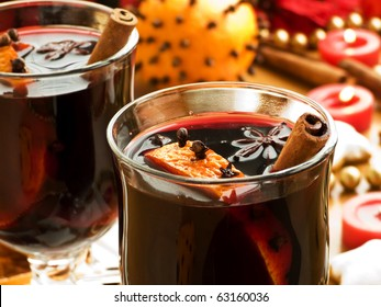 Mulled wine with slice of orange and spices. Shallow dof.