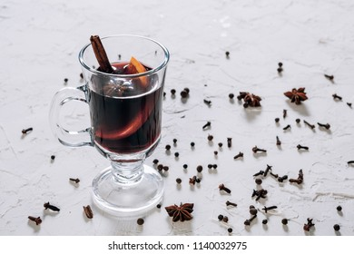 Mulled wine with spices and empty space for text on white background