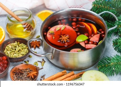 Mulled wine is a traditional winter drink with red wine, honey, orange, Apple, cranberry and spices - cinnamon, cardamom, star anise, cloves, ginger. grog. punch. Christmas. New year. Selective focus