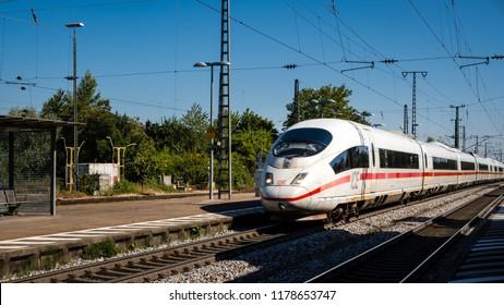 Mullheim, Baden-Wurttemberg, Germany - JULY 30 2018 : ICE 3 Intercity-Express high-speed train of the Deutsche Bahn (DB) passing the Mullheim railway station