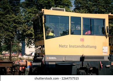 Mullheim, Baden-Wurttemberg, Germany - JULY 31 2018 : Worker coupling carriage to network maintenance vehicle from the Deutsche Bahn in the Mullheim trainstation