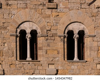 mullioned windows on the wall of a medieval building in Tuscany, Italy