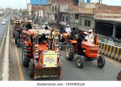 MULTAN, PAKISTAN - MAR 19: Members of Pakistan Kissan Ittehad are holding Kissan  Tractor March against price hike of fertilizers and other agricultural inputs, on March 19, 2021 in Multan.