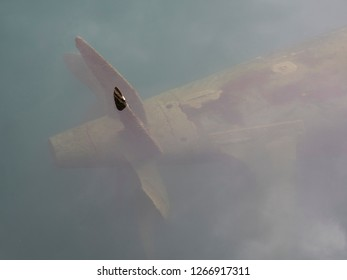 multi blade portpropeller of an old war submarine semi-submerged in the waters of the  port