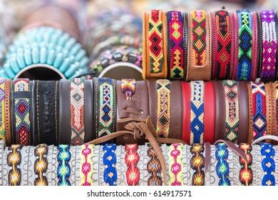 multi color bracelet on display stand