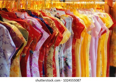 Multi color of cheongsam or qipao dress hanging for sale in chinese traditional market
