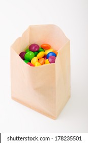 Multi color crunchy candies in a paperbag